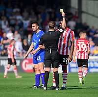 Lincoln City's John Akinde is shown a yellow card by referee Anthony Backhouse<br /> <br /> Photographer Chris Vaughan/CameraSport<br /> <br /> The EFL Sky Bet League Two - Lincoln City v Tranmere Rovers - Monday 22nd April 2019 - Sincil Bank - Lincoln<br /> <br /> World Copyright © 2019 CameraSport. All rights reserved. 43 Linden Ave. Countesthorpe. Leicester. England. LE8 5PG - Tel: +44 (0) 116 277 4147 - admin@camerasport.com - www.camerasport.com