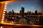 Skyline of Chicago from Ferris Wheel on the pier in Chicago, USA. George W. Ferris built the Ferris Wheel for the 1893 World's Fair, which was held in Chicago to commemorate the 400th anniversary of Columbus's landing in America. The Chicago Fair's organizers wanted something that would rival the Eiffel Tower. Gustave Eiffel had built the tower for the Paris World's Fair of 1889, which honored the 100th anniversary of the French Revolution..Copyright: Helen Atkinson 2008 +447976265253