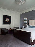 The bedroom is furnished with a custom made sleigh bed complemented by a colour palette of grey and aubergine