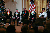 United States President Barack Obama and First Lady Michelle Obama host the 2010 Kennedy Center Honorees to a reception in the East Room of the White House before going to the Kennedy Center.  The recipients for the 33rd annual awards, from left to right are: singer and songwriter Merle Haggard; composer and lyricist Jerry Herman; dancer, choreographer and director Bill T. Jones; songwriter and musician Paul McCartney; and producer, television host and actress Oprah Winfrey.  .Credit: Gary Fabiano / Pool via CNP