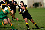 Bombay's left wing B. Tribe looks to fend off the tackle of S. Joyce.Counties Manukau Premier Club Rugby, Drury vs Bombay played at the Drury Domain, on the 14th of April 2006. Bombay won 34 - 13.