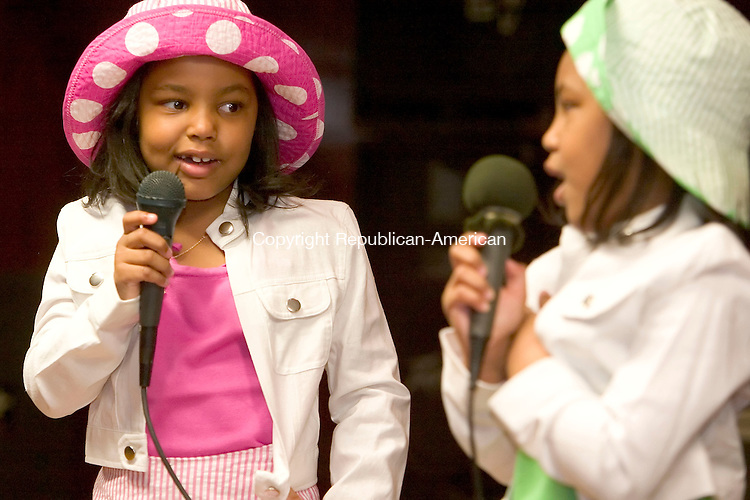 WATERBURY, CT--08 APRIL 2007--040807JS01-Twin sisters Janay McBird and Jaelen McBird sing a song during the Goodwill Lodge #1325 and Clock City Temple #895's Beauty and Talent Department Annual Easter Fashion and Talent Show Sunday at the Goodwill Lodge in Waterbury. To view a slideshow from this event, go to www.rep-am.com.<br /> Jim Shannon / Republican-American