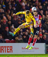 Lincoln City's Neal Eardley vies for possession with  Milton Keynes Dons' Rhys Healey<br /> <br /> Photographer Andrew Vaughan/CameraSport<br /> <br /> The EFL Sky Bet League One - Lincoln City v Milton Keynes Dons - Tuesday 11th February 2020 - LNER Stadium - Lincoln<br /> <br /> World Copyright © 2020 CameraSport. All rights reserved. 43 Linden Ave. Countesthorpe. Leicester. England. LE8 5PG - Tel: +44 (0) 116 277 4147 - admin@camerasport.com - www.camerasport.com