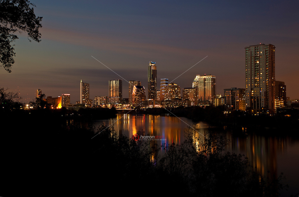 New Austin Skyline from Travis Heights with lights reflecting on the calm waters of Lady Bird Lake