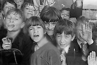 Pressing faces against the window, Whitworth Comprehensive School, Whitworth, Lancashire.  1970.