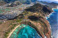An aerial view of Hawai'i Kai, including Hanauma Bay in the foreground and Koko Crater in the distance, Southeast O'ahu.
