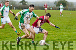 Shane Kenny, Ballybrown, and Emmet Casey, Cromane, fight for the ball during their sides clash in the Munster Junior B Club Football Final in Knockaderry