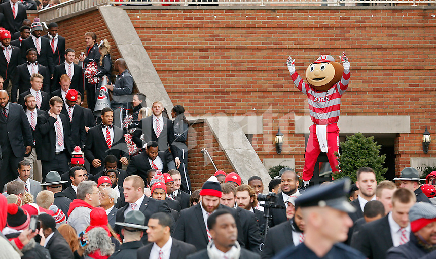 Brutus Buckeye cheers as Ohio State Buckeyes players leave the The Blackwell Inn before the start of their game against Michigan Wolverines at Ohio Stadium in Columbus, Ohio on November 29, 2014.  (Dispatch photo by Kyle Robertson)