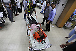 A Palestinian role-playing as an injured person is transported on a moving hospital bed into a hospital during an emergency drill for treating mass casualties organised by French humanitarian organisation Medecins du Monde (Doctors of the World), at the European Gaza Hospital in Khan Yunis in the southern Gaza Strip on September 16, 2019. Photo by Ashraf Amra