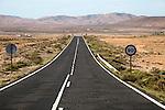 Straight tarmac road crossing desert, Fuerteventura, Canary Islands, Spain