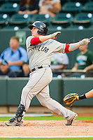 Christian Vazquez #12 of the Salem Red Sox follows through on his swing against the Winston-Salem Dash at BB&T Ballpark on May 5, 2012 in Winston-Salem, North Carolina.  The Red Sox defeated the Dash 6-4.  (Brian Westerholt/Four Seam Images)