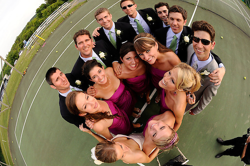 The bridal party dances around the newlyweds on a tennis court at Total Tennis in the Catskills - Saugerties, New York.