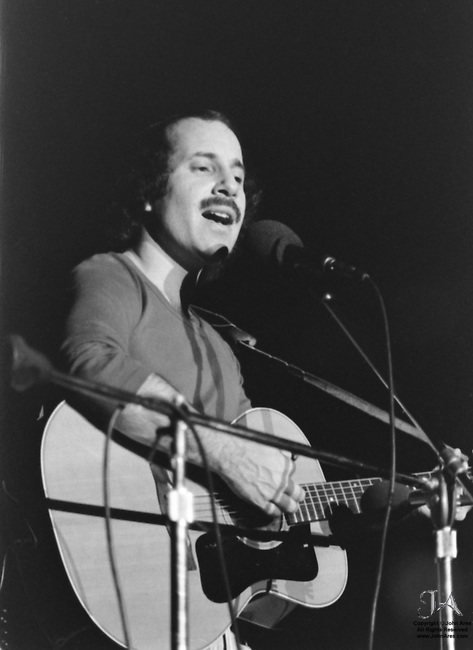 October 24 1975, Paul Simon performing at Seton Hall University and Playing guitar, and singing