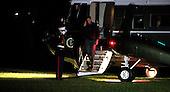 United States President Barack Obama salutes the Marine Guard as he returns to the White House in Washington, DC on November 16, 2014.  <br /> Credit: Dennis Brack / Pool via CNP