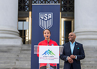 Denver, CO - April 3, 2019: Mallory Pugh and Lindsey Horan receive challenge coins from Denver Mayor Michael B. Hancock.