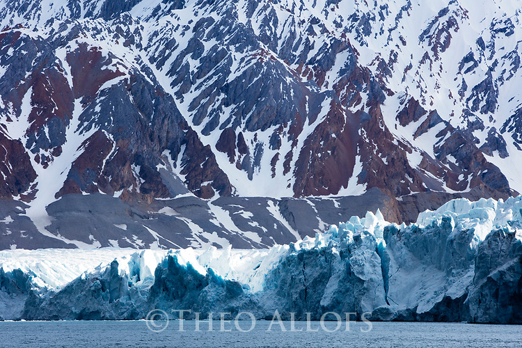 Norway, Svalbard, mountains and glacier front in late spring