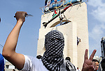 A Palestinian youth holds a knife in front of a mock Qassam rocket during an anti-Israeli protest in Rafah n the southern Gaza Strip, October 20, 2015. Triggered by Israeli incursions into the Al-Aqsa Mosque compound last month, violence and protests against Israel's occupation have increased in frequency across the West Bank, including East Jerusalem, and the Gaza Strip. Photo by Abed Rahim Khatib