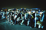 Hundreds of Roma, Kosovo War refugees, arrive at Bari Red Cross clearing camp. They traversed the Adriatic by Mafia boat. often paying up to one thousand dollars per ticket. Many boats capsized and hundreds lost their lives. They will be checked, processed and given Red Cross identity cards, and eventually able to seek a new life in Italy and Western Europe. Bari, Italy 1999