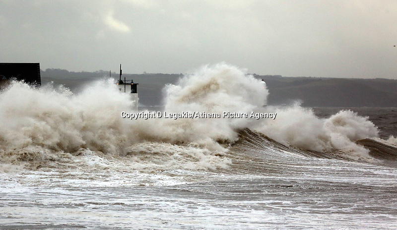 WEATHER PICTURE WALES<br /> Pictured: Giant waves crashing against the lighthouse wall in the seaside town of Porthcawl, south Wales, UK. Wednesday 05 February 2014<br /> Re: Strong winds combined with high tides cause flood warnings in many parts of the UK