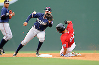Second baseman Ross Wilson (16) of the Rome Braves takes the throw and tags out Tzu-Wei Lin of the Greenville Drive trying to steal second in a game on Friday, August 1, 2014, at Fluor Field at the West End in Greenville, South Carolina. Rome won, 5-1. (Tom Priddy/Four Seam Images)