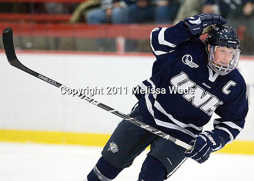 Damon Kipp (UNH - 4) - The Harvard University Crimson defeated the University of New Hampshire Wildcats 7-6 on Tuesday, November 22, 2011, at Bright Hockey Center in Cambridge, Massachusetts.