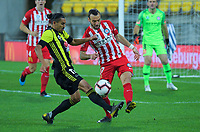 David Williams tries to tackle Florin Berenguer-Bohrer during the A-League football match between Wellington Phoenix and Melbourne City FC at Westpac Stadium in Wellington, New Zealand on Sunday, 21 April 2019. Photo: Dave Lintott / lintottphoto.co.nz