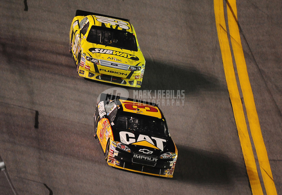 Jul. 3, 2010; Daytona Beach, FL, USA; NASCAR Sprint Cup Series driver Jeff Burton (31) leads Carl Edwards (99) during the Coke Zero 400 at Daytona International Speedway. Mandatory Credit: Mark J. Rebilas-