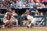 Michigan Wolverines outfielder Christian Bullock (5) follows through on his swing during Game 6 of the NCAA College World Series against the Florida State Seminoles on June 17, 2019 at TD Ameritrade Park in Omaha, Nebraska. Michigan defeated Florida State 2-0. (Andrew Woolley/Four Seam Images)