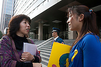 Artist Rena Masuyama and Yukie Tokura wait to meet officials at METI during an Anti nuclear protest by women outside the Ministry of Economy, Trade and Industry (METI) in Tokyo Japan. Friday November 4th 2011. The protest ran from October 27th to Noverber 5th. Originally started my mothers from Fukushima protesting about nuclear contamination from October 30th to November 5th the protest welcomed women and people from all over Japan.