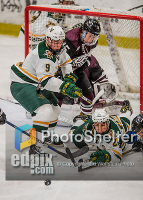 18 December 2016: University of Vermont Catamount Forward Brian Bowen (9), a Sophomore from Littleton, MA, and Forward Brendan Bradley (20), a Senior from Warminster, PA, work in front of the net during the third period against the Union College Dutchmen at Gutterson Fieldhouse in Burlington, Vermont. The Catamounts fell to their former ECAC hockey rivals 2-1, as the Dutchmen sweep the two-game weekend series. Mandatory Credit: Ed Wolfstein Photo *** RAW (NEF) Image File Available ***