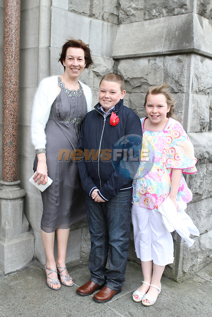 James Castle with his mother Maria and sister Sarah at Le Cheile Confirmation in St.Mary's Church...(Photo Jenny Matthews/www.newsfile.ie)