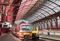 Passenger trains and the atrium on the main level of Antwerp's Central Station