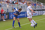 Lori Lindsey (6) blocks a shot by Birgit Prinz (9) at SAS Stadium in Cary, North Carolina on 4/5/03 during a game between the Carolina Courage and Washington Freedom. The Washington Freedom won the game 2-1.