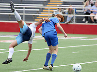 NWA Democrat-Gazette/DAVID GOTTSCHALK  Springdale Har-Ber Wildcats' Juan Mejia flips over Conway Wampus Cats' Evan Trimble during first half play at the 7A 2017 State Soccer Tournament at Mayo-Thompson Stadium at Fort Smith Northside High School. Springdale Har-Ber won 2-0.