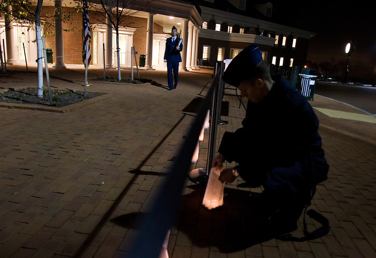 Air Force R.O.T.C. Cadet Captain Tyler Peery, 19, is a sophomore at Ohio University. He marches in memory of U.S. POWs and those missing in action while Cadet Third Class,  Brent Yocum, 19, Sophomore at O.U. lights a candle on Veteran's Day in Athens, Ohio, Sunday, Nov. 11, 2007. Tyler is studying Astrophysics Aviation. Yocum is studying Aviation Management. (Ohio University /CHAD BARTLETT)