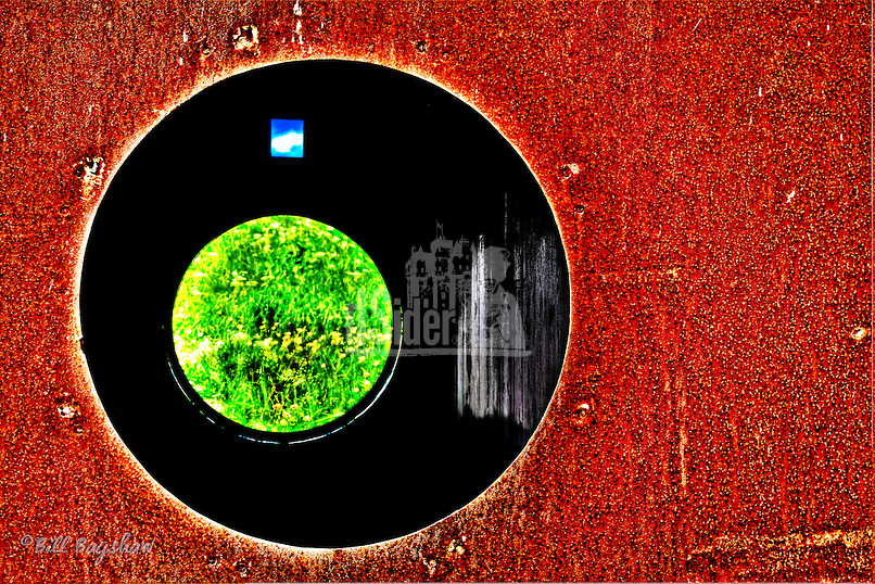 A round window is an unusual feature found on this rusting carriage from the Deeside Railway Line.<br />