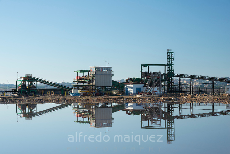 Industrial machinery reflex at sea salt marsh, Salt industry. Torrevieja. Alicante. Spain
