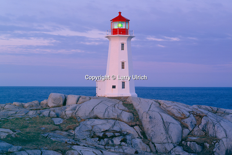 Granite headland<br />    and Peggy's Point Lighthouse at dawn<br /> Peggy's Cove Preservation Area<br /> Nova Scotia, Maritime Provinces, Canada