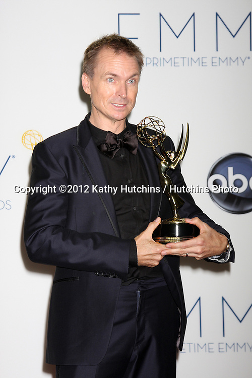 LOS ANGELES - SEP 23:  Phil Keoghan in the press room of the 2012 Emmy Awards at Nokia Theater on September 23, 2012 in Los Angeles, CA