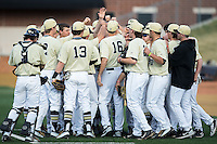 The Wake Forest Demon Deacons huddle up prior to the start of their game against the UConn Huskies at Wake Forest Baseball Park on March 17, 2015 in Winston-Salem, North Carolina.  The Demon Deacons defeated the Huskies 6-2.  (Brian Westerholt/Four Seam Images)