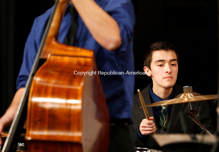 """Torrington, CT- 09 March 2015-030915CM04-  Brandon Charron a junior at Torrington High School and member of the Torrington HS Jazz Combo, plays along to """"September in the Rain"""", by Harry warren, during a concert at Torrington high school on Monday. The Jazz combo opened up for for The McNally Smith Jazz Orchestra, from Minnesota during a concert at the Little Theater.  Christopher Massa Republican-American"""