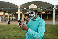 NWA Democrat-Gazette/BEN GOFF @NWABENGOFF<br /> A participant touches up his makeup Friday, Nov. 2, 2018, before a Dia de los Muertos procession from Shiloh Square to the Arts Center of the Ozarks in downtown Springdale.