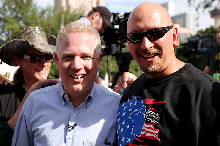 Television and radio host Glenn Beck, left, poses with a fan during a public appearance, Wednesday, April 15, 2009, at the Alamo in San Antonio. (Darren Abate/pressphotointl.com)