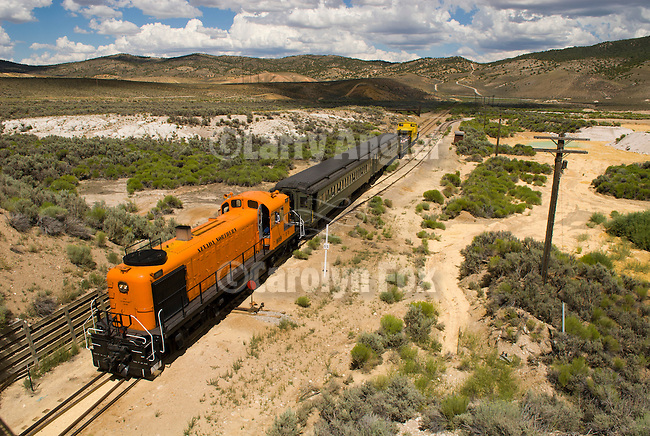 Nevada Northern Railway historic diesel passenger train pulled by No. 109. 1950 Alco RS-3 locomotive on the Keystone Route toward Ruth..At the Keystone Wye, Ruth, Nevada.