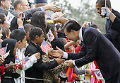 President Lee Myung-bak (C) of the Republic of Korea and United States President Barack Obama (2rd R) greet guests during an arrival ceremony on the South Lawn of the White House, Thursday, October 13, 2011 in Washington, DC. Later in the day Lee is scheduled to hold a joint press conference with Obama and also address a joint meeting of Congress. .Credit: Alex Wong / Pool via CNP