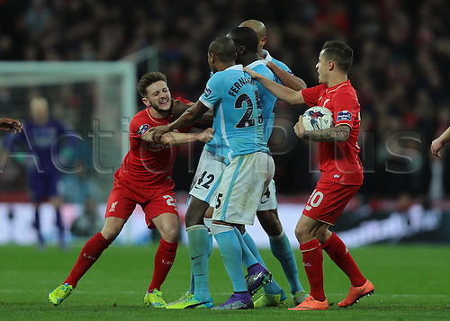 28.02.2016. Wembley Stadium, London, England. Capital One Cup Final. Manchester City versus Liverpool. Tempers fray as Liverpool Midfielder Adam Lallana and Manchester City Midfielder Yaya Touré come to blows, and both receive yellow cards