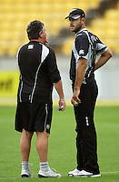 Black Caps coach Andy Moles and captain Daniel Vettori discuss tactics before the third spell after rain-interrupted play during the 2nd ODI cricket match between the New Zealand Black Caps and India at Westpac Stadium, Wellington, New Zealand on Friday, 6 March 2009. Photo: Dave Lintott / lintottphoto.co.nz