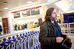 Marc Borms, of Brussels, waits for his luggage at Hartsfield-Jackson Atlanta International Airport  after a flight from Brussels in Atlanta, Georgia January 6, 2009.  Borms said security even checked inside the book he brought onto the plane.