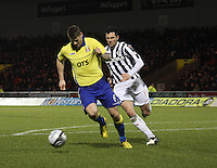 Michael Nelson gets the better of Steven Thompson in the St Mirren v Kilmarnock Clydesdale Bank Scottish Premier League match played at St Mirren Park, Paisley on 2.1.13.
