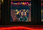THOMASTON, CT. 08 December 2018-120818 - Tucker McCann, 1, of Ledyard all dressed warm in his pajamas looks out the window from the 1891 Rutland combine car, looking for Santa during The Northern Lights Limited train ride with Santa and his elves at the Railroad Museum of New England in Thomaston on Saturday. Bill Shettle Republican-American